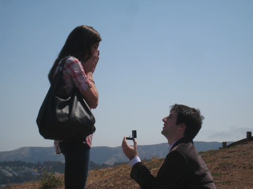 marriage proposal on top of the hill